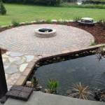 backyard paver firepit with pond